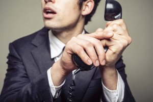 Businessman covering the phone